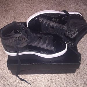 Black sparkly high top sneakers